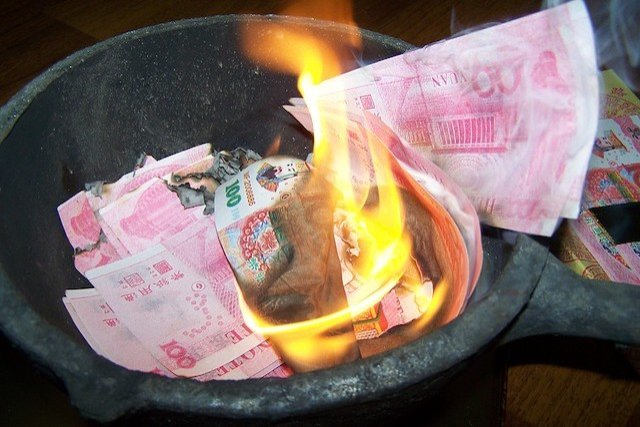 Qing Ming Festival or Tomb Sweeping Day burning paper money