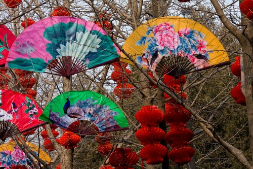 Beautiful Decorations, bright red lanterns, colorful fans at Ditan Temple Fair in  Beijing