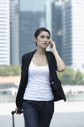 Woman using cell phone in China