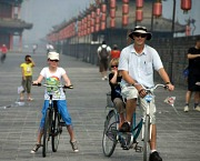 Children biking on the Xian City Wall