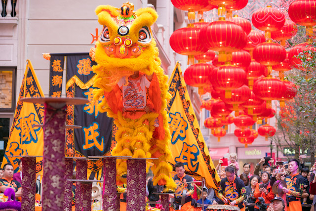 Two Lion Dancers: One hold the head the other one the body