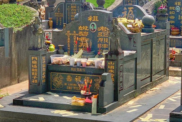 Qing Ming Festival or Tomb Sweeping Day tombs with food offering