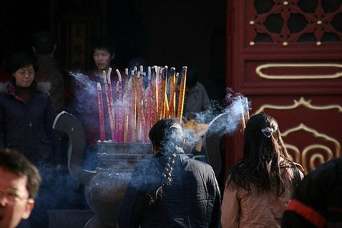People come to pay respects and honor the ancestors during Chinese New Year at Ditan Temple Fair in  Beijing
