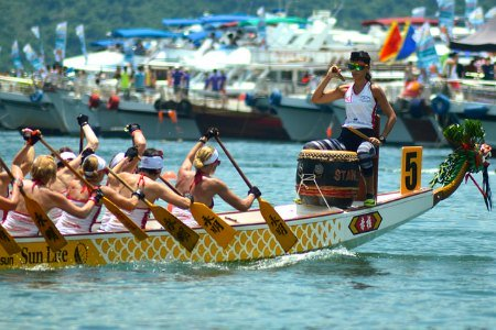 Chinese Dragon Boat Festival - A  drummer sits in the front  and sets the pace by pounding a large drum