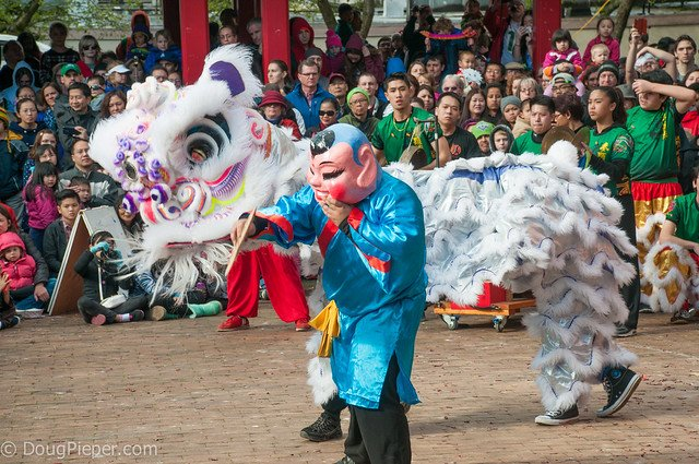 Chinese Lion and Laughing Buddha performing at Chinese New Year Parade