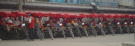 Rickshaws in a row by the Beijing Hutongs